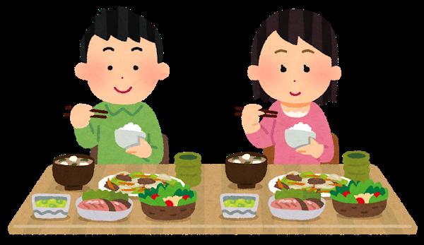 ご飯を食べる夫婦